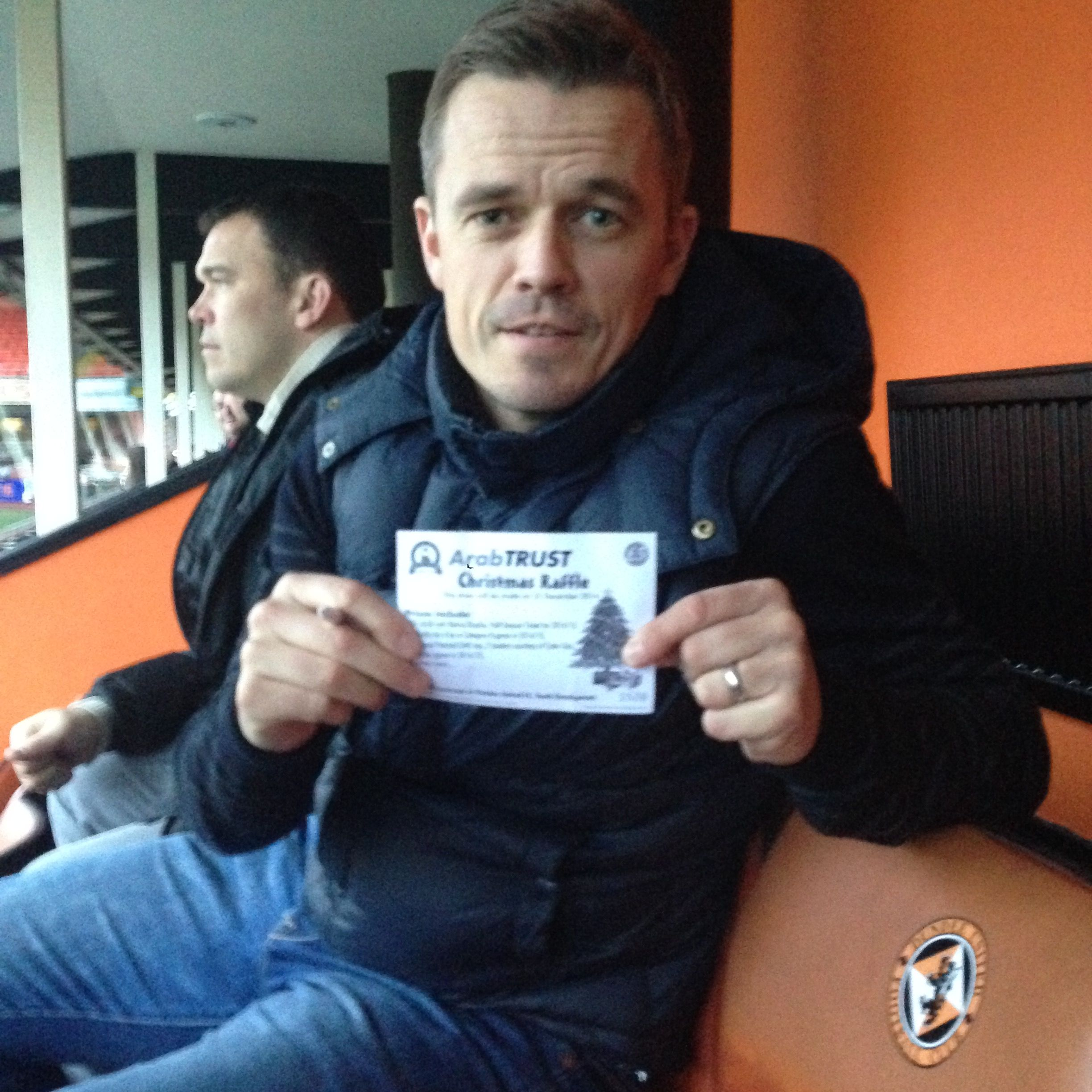 Dundee United Assistant Manager Simon Donnelly with his Christmas Raffle ticket
