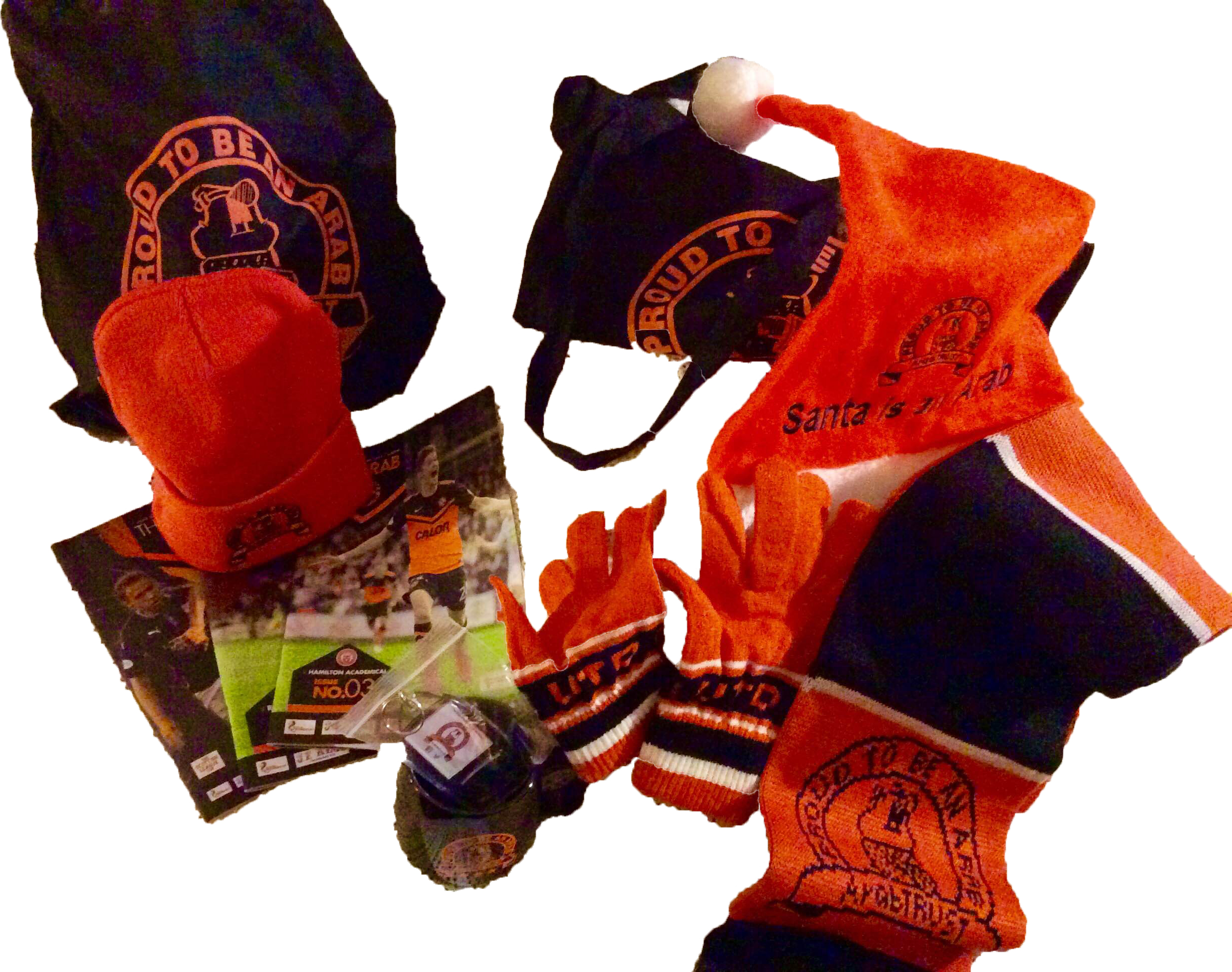 "The Kid's Goodie Bag containing: Bar Scarf, the latest ""UTD"" Gloves, Tangerine Beannie, Santa is an Arab Hat, Keyring and other Goodies. Only £20"