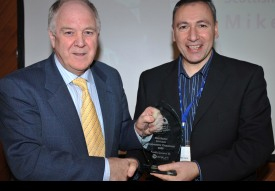 Mike Barile receiving an award in Belfast as Scotland's Football Without Frontiers (FWF) Community Champion