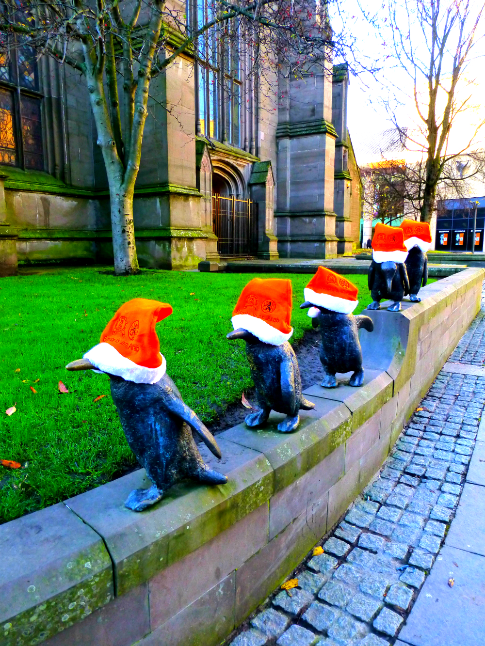 "The Dundee Penguins spotted on the march wearing their ""Santa is an Arab"" Hats"