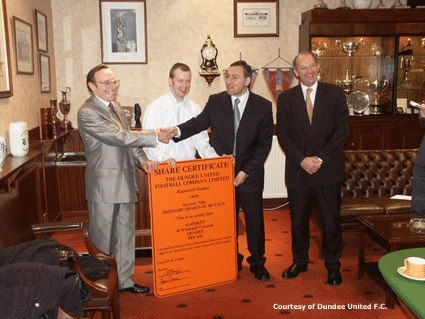 Dundee United Supporters' Trust 'ArabTRUST' accepting a number of shares from United Chairman Eddie Thompson