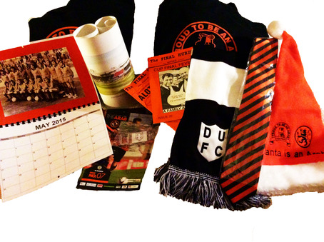 Adult Christmas Goodie bag containing: The Retro Scarf, United Tie, Calendar, Barcelona Print, Final Hurdle Issues, Santa is an Arab Hat & other Goodies. Exceptional value with Christmas all wrapped up in one. Only £30