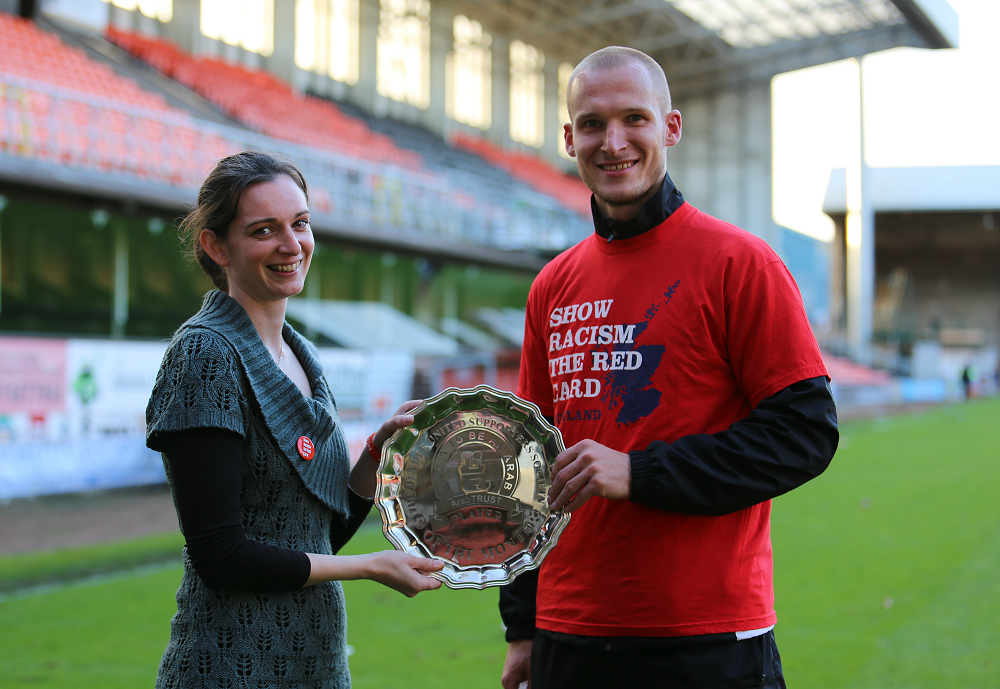 Player of the Month Jarek Fojut with Ruth McGeoch.